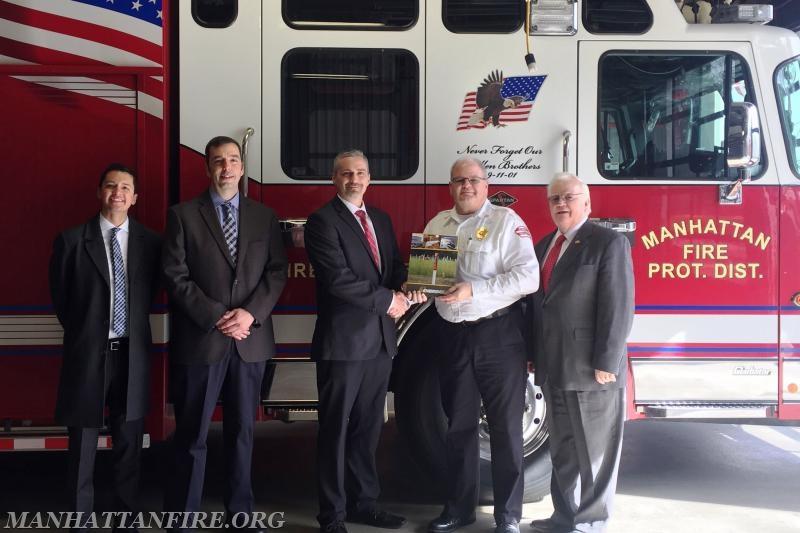 (l to r)  Enbridge representatives Taylor Smith, Al Diaz, and Dave Bareman, Manhattan Fire Chief Dan Forsythe, Will County Executive Larry Walsh