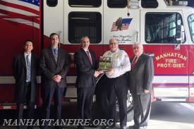 (l to r)  Enbridge representatives Taylor Smith, Al Diaz, and Dave Bareman, Manhattan Fire Chief Dan Forsythe, Will County Executive Larry Walsh