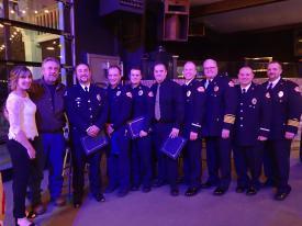 EMS Life Save Award- Mr. & Mrs. Pfizenmaier, Justin Pfizenmaier, Kyle Eller, Alec Spagnoli, Marcis DuBois, Lt. Jon Christensen, Chief Dan Forsythe, Lt. Ed Ludwig, DC Steve Malone